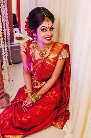 South Indian bride. Temple jewelry. Jhumkis.Classic red silk kanchipuram sari.Braid with fresh flowers. Tamil bride. Telugu bride. Kannada bride. Hindu bride. Malayalee bride.