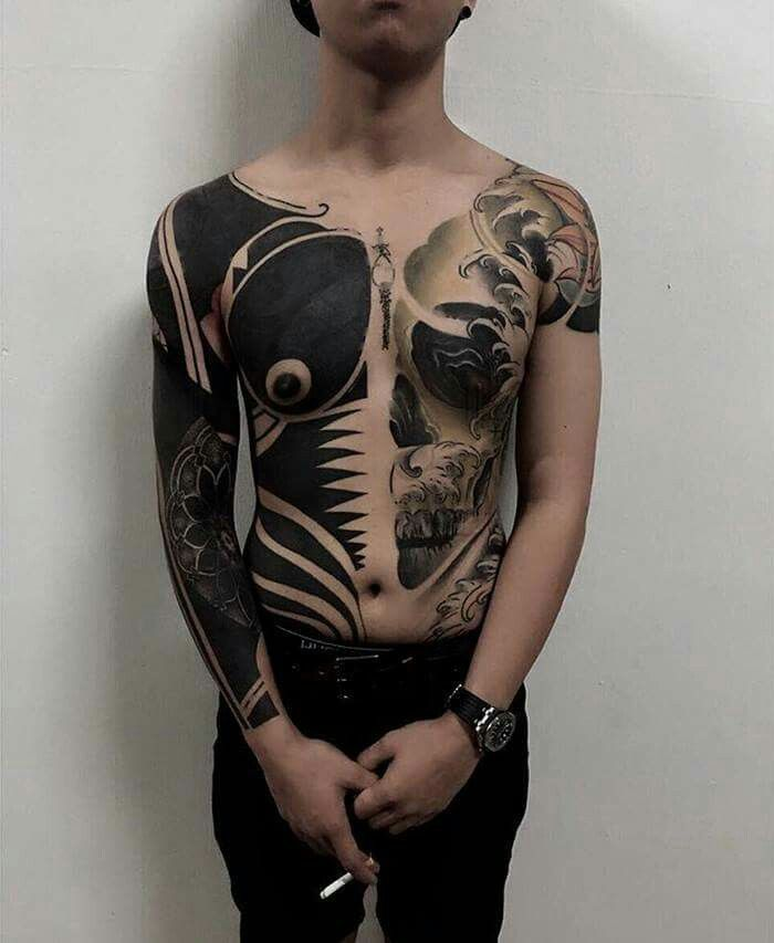 Check out the latest trend in Singapore! Yes, blacked-out tattoos! These are from tattoo artist Chester Lee of the Oracle Tattoo Shop.