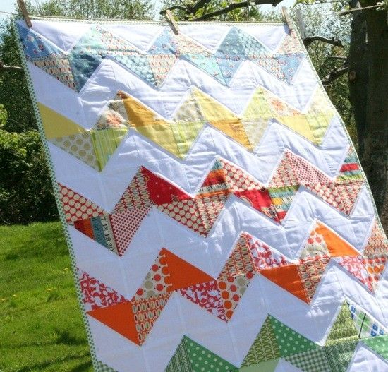 CHEVRON QUILT - EASY by ann white triangles sewn to colored triangles, greens, blues, yellows, oranges