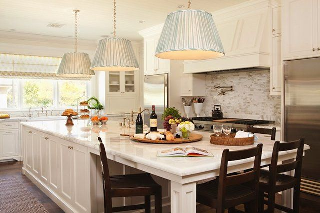 Kitchen Island with built in dining table, brilliant (I'd need to change out those lighting fixtures though)