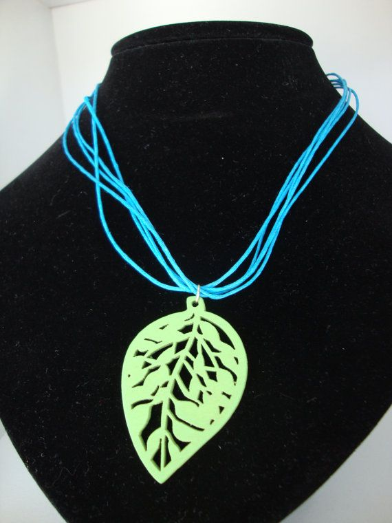 Leather look necklace with a wooden leaf pendant