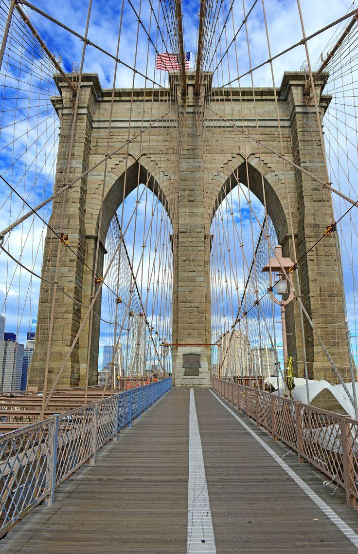 Take a walk or drive down Brooklyn Bridge, an iconic landmark in New York City.
