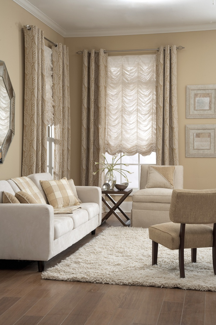 A transitional setting with sheer Austrian roman shades and functional Grommet curtains