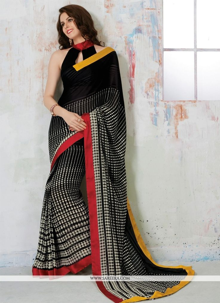 Fashion and trend would be at the peak of your elegance the moment you attire this black satin and georgette casual saree. This charming attire is showing some remarkable embroidery done with print wo...