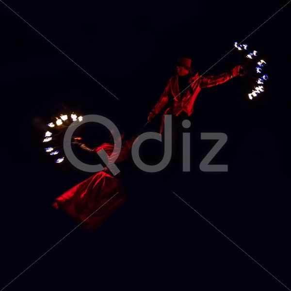 Qdiz Stock Images Boy and girl dancing with fire,  #action #blaze #boy #burn #burning #burnt #cube #dance #danger #editorial #effect #effort #energy #evil #fiery #fire #firebrand #fireshow #firewall #flame #flametongue #flammable #furious #girl #glowing #heat #hell #hellfire #hot #ignite #igniting #illuminated #illustrative #inferno #licking #light #man #motion #night #passion #power #show #smoke #swirl #warm
