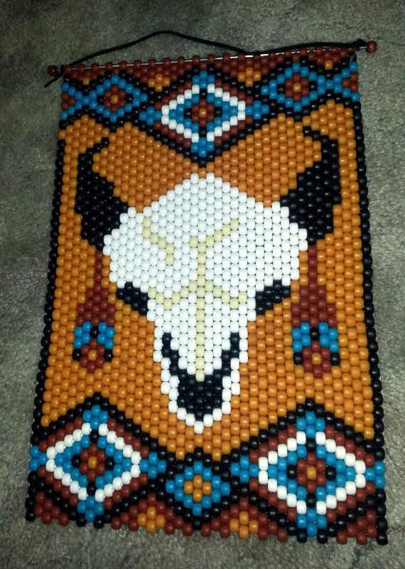 Sacred Buffalo Beaded Banner is approx. 15 X 10. Makes a beautiful southwestern wall hanging, door Hanger or window hanging. The image can be seen from either side and hung in either direction.