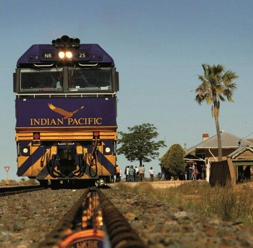 I never worked in Australia but this is one of my favorite railroading pictures. The world famous passenger train, the Indian Pacific, is stopped at Rawlina in Western Australia while the freshly ground rail head perfectly reflects the blue locomotive. Perfect.