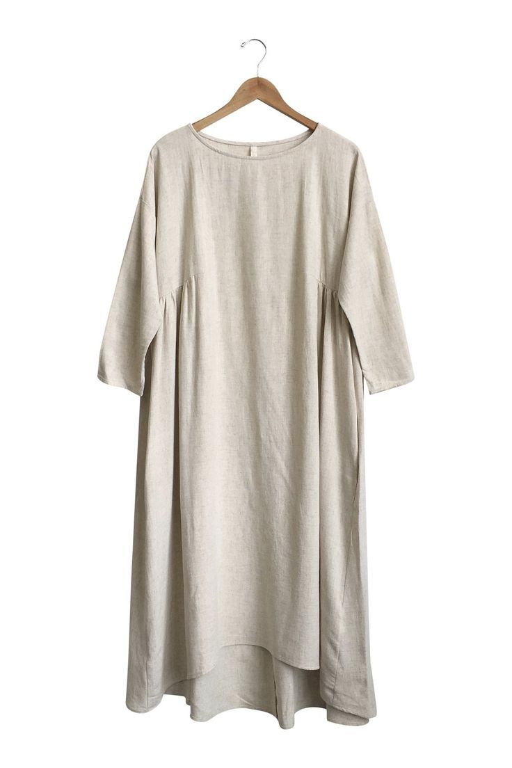 3/4 Sleeve Linen Dress  Also available in Light Blue  Gathering Detail on Sides  Side Pockets  Hi-Lo Hem  Runs a size big  Model is 5'7 and wearing a small