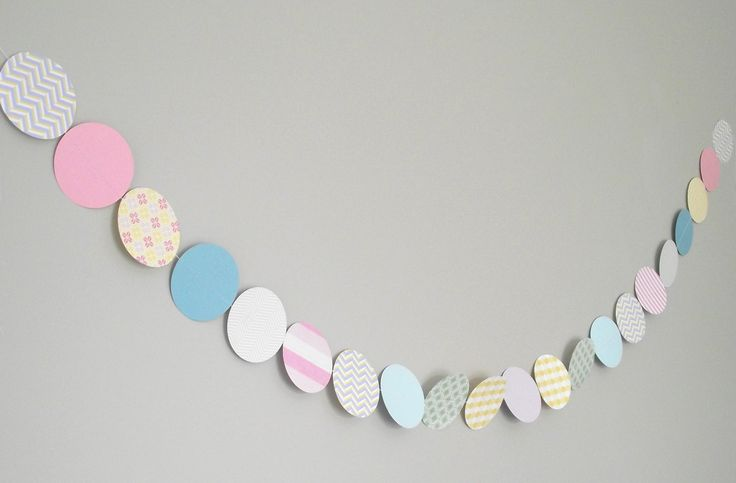 Paper garlands made to order. Perfect for parties, special occasions, and room décor. Quality cardstock in your choice of colours, patterns, shapes and sizes. Hang vertically or drape horizontally as shown.