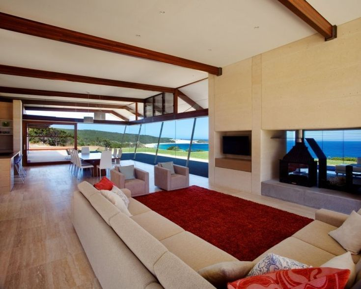 Stunning View From A Modern Minimalist House:large-living-room-with-big-cream-color-sofa-cushion-red-furry-rug