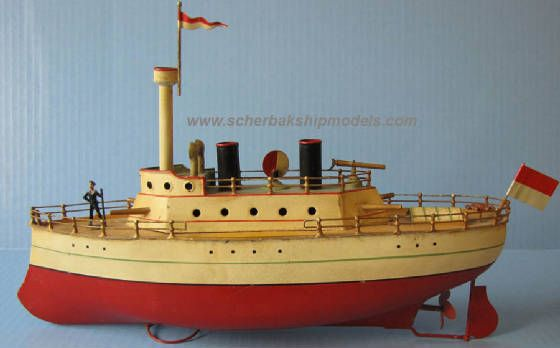 "Gerbruder Bing Tin Ocean Liner Model,  ca.1920s. 15"" (38 cm) long. Made in Germany. Excellent condition. Original paint. Not sure about flags and rigging. Clockwork motor works very well. Key is included."