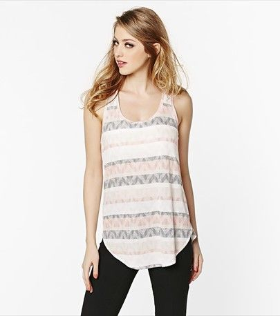 Sexy meets ethnic with this soft aztec print tunic!