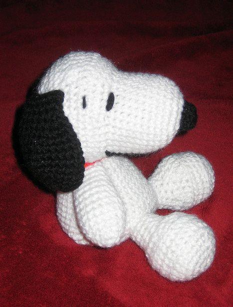 Snoopy , found on : http://www.amigurumipatterns.net/Cartoons-and-Games/Amigurumi-Snoopy/