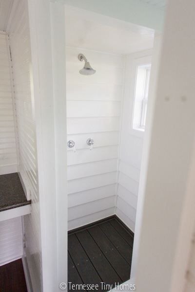 tiny happy homes shower.  Looks like Trex decking for the floor, spaced a bit apart for drainage.  I like this look ~ it's sorta beachy and cute.