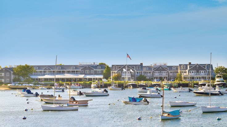 Stay at The White Elephant hotel in Nantucket and enjoy beautiful views of sailboats on the harbor.