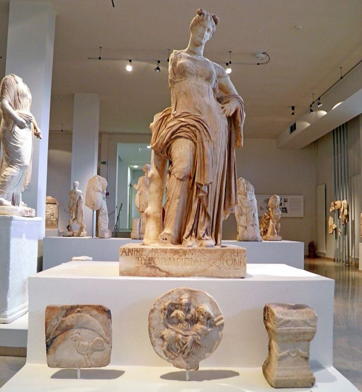 Marble cult statue of Aphrodite Hypolympidia and votive ...