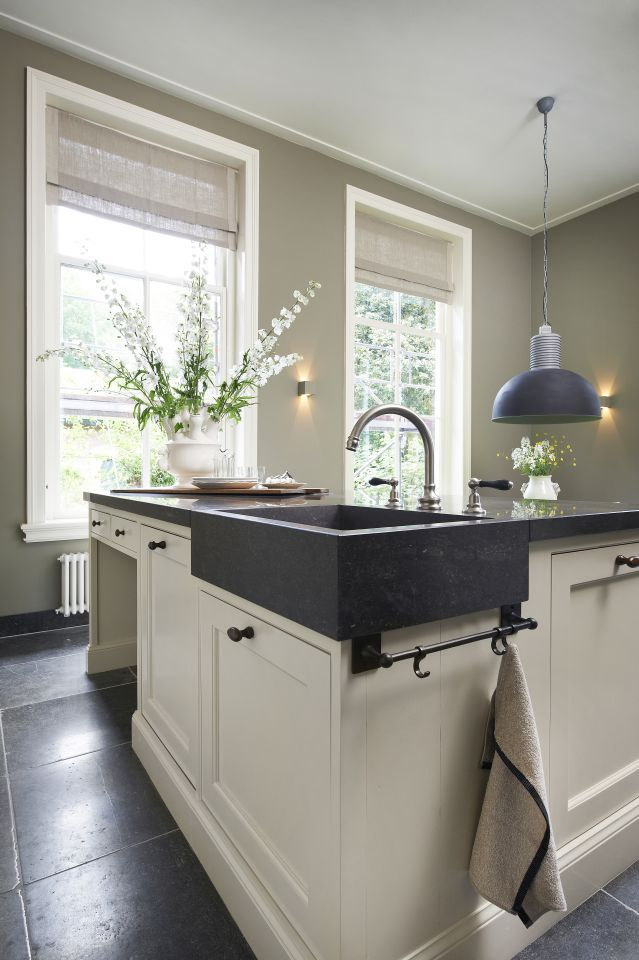 island with soapstone sink, black hardware, dark stained wood floor