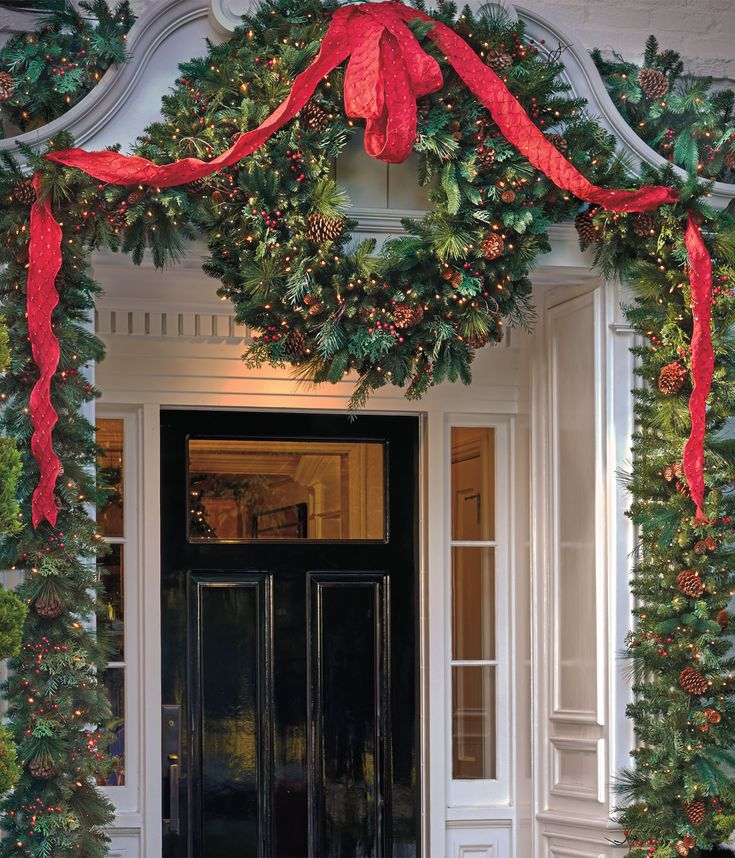 Christmas Greenery & Ribbon Entry  I just wish my front door/entrance was this pretty to begin with...not sure how I could pull this off on my plain ranch house....