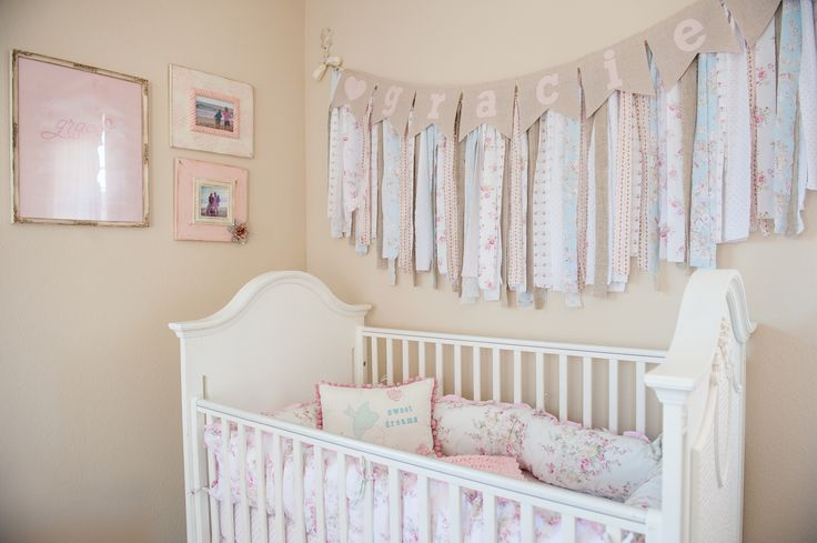 A shabby chic nursery designed for Gracie. Light pinks and ditzy florals made it feminine and the vintage furniture gave us a shabby chic design.
