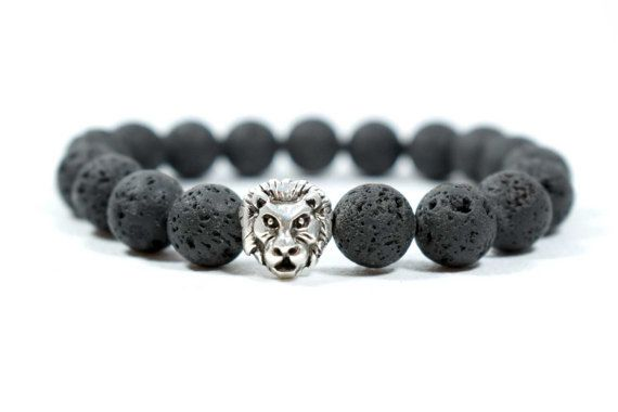 Men's Black Lava beads Bracelet, with a Gunmetal Lion Head. This elegant Strength & Fortune Bracelet is an excellent personal accessory for the Boho Man. Made from AA Grade 10mm Black Lava Beads on high quality transparent stretch cord.    A great handmade gift with style & character, for yourself or for people you love. Comes with a beautiful small gift bag!    Details:    10mm Black Lava Beads  Silvertone Metal Lion Head  Quality Transparent Stretch Cord    *** IMPORTANT When you select…