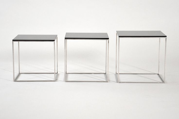 "Poul Kjærholm (1929-1980). ""PK-71"". Set of three nesting tables with cube-shaped chromed steel frame, and black acrylic tops. Designed in 1957. Produced by Fritz Hansen. #PoulKjærholm #PK71"