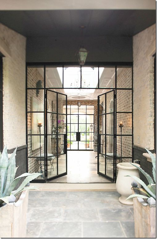 Steel enfilade, glass, brick entry