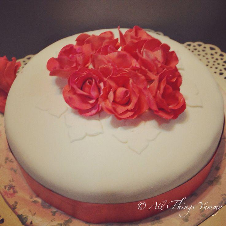 Floral Cake Decor - White and Red Classic Fondant Cake with Red Roses Floral Cake Decor | All Things Yummy #redroses #weddingcake #redandwhite #designercake #customcake #ribbon #redribbon #floral #flowers #atyummy #cake #delhibakers #homebakery