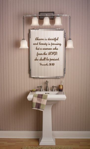 """Vinyl Wall Decal """"Charm is deceitful and beauty is passing, but a woman who fears the LORD, she shall be praised"""". $13.95, via Etsy."""