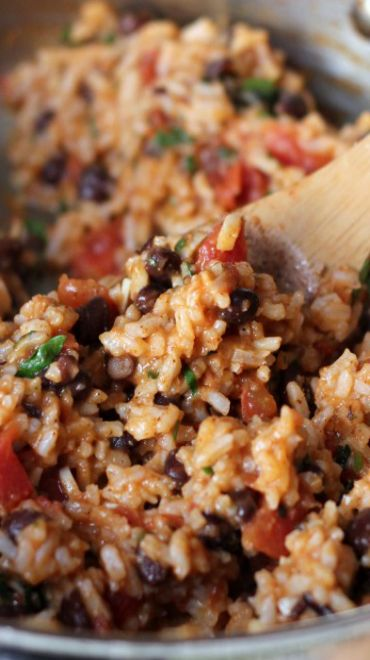 Mexican Tomato Rice and Beans (another pinner wrote: I would substitute pinto beans for the black beans and use green chilis instead of a jalapenos.)