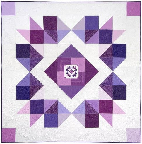 "Orchid Mega quilt pattern was designed by Ramona Rose for Robert Kaufman Fabrics. Uses Kona Cotton solids in a variety of purples form the Kona Cotton Fields of Iris fat quarter bundle.  Finished size: 95"" x 95"""
