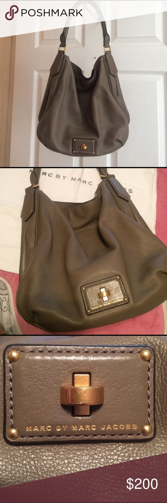 💕SALE💕 Marc Jacobs Hobo Shoulder Bag💕 Marc by Marc Jacobs bag is in great condition! Has been gently used and has no signs of wear or cracking on the handle or bottom of the bag. Dark interior and beautiful taupe color on the outside! Offers welcome but please NO lowballing. Marc Jacobs Bags Hobos