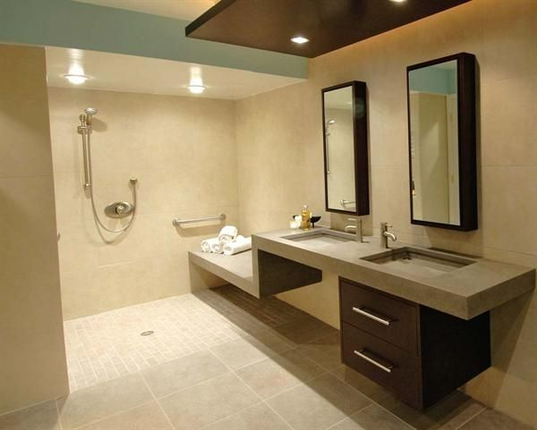 Really nice design for dual sinks and all access.  I could see the wall that the sinks and the bench are on disappear...the bench could be attached to a bathtub on the other side and the sinks could be accessed from either side, drawers pulling out on both sides.