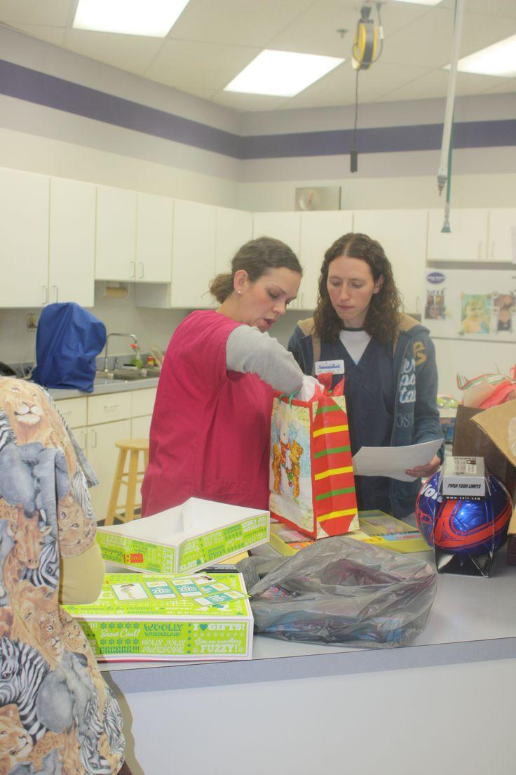 Tiffanie and Julie wrapping gifts. #Animal Hospital #Veterinarian #Pets #Vet #KAH #FrederickMaryland #Christmas #GivingBack