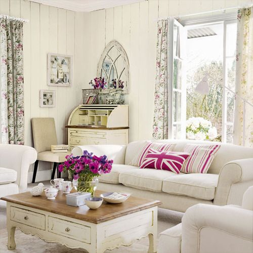 Really pretty white and cream. I love the secretary in the back. So much nicer to have a living room like that where you can talk, write your letters and exist! Bright and airy.