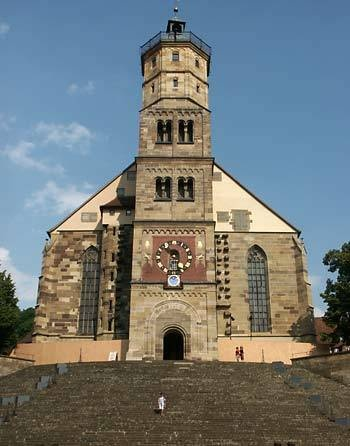 From the top of this bell tower my main character sees soldiers setting up for a Nazi Rally.