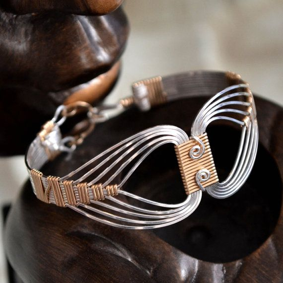Egyptian wire wrapped Bracelet with a Twist. Sterling Silver and 14K Gold filled