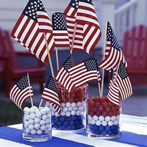 American flags make great centerpieces in a base of red, white, and blue Sixlets