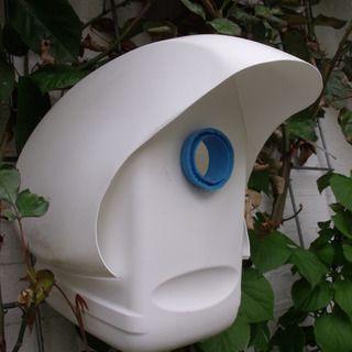 Plastic bottle birdhouse made from laundry detergent bottles