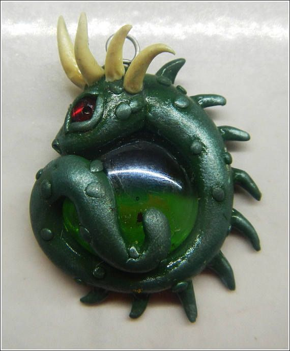 Green Dragon with red eye ivory horns protecting a green