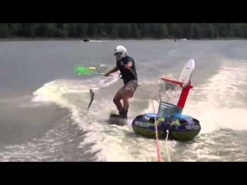This is Skarping. A sport that combines water skiing and fishing for flying carp. And it is amazing. - YouTube