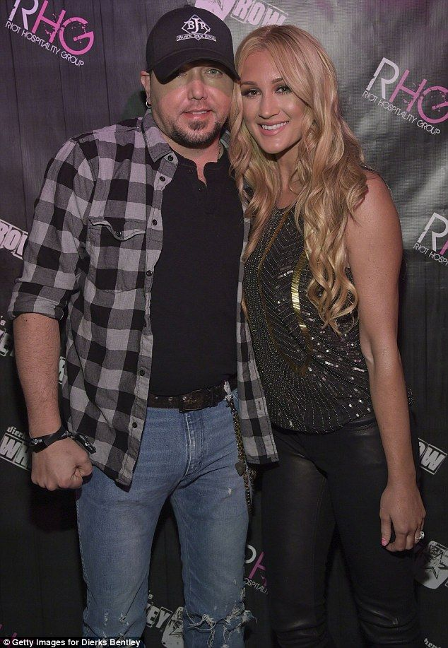 A second chance at love: Aldean was previously married to his high school sweetheart of 12 years before dating Kerr in 2012 - he divorced the mother of his two daughters in 2013; seen above, the pair attended Dierks Bentley Whiskey Row in January
