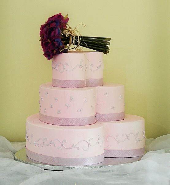 A pink heart shaped wedding cake. Cake # 012.