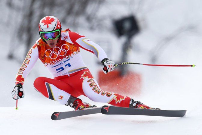 Canada's Erik Guay makes a turn during the men's downhill.
