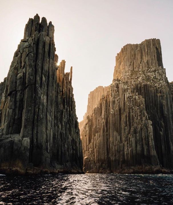 Nothing quite gives you the feeling of being small when floating in a small boat at the bottom of the tallest sea cliffs in the Southern Hemisphere. Image sent in by Laura Alyce Bell from the Tasman Peninsula: https://instagram.com/p/BE5pf4_mTli/