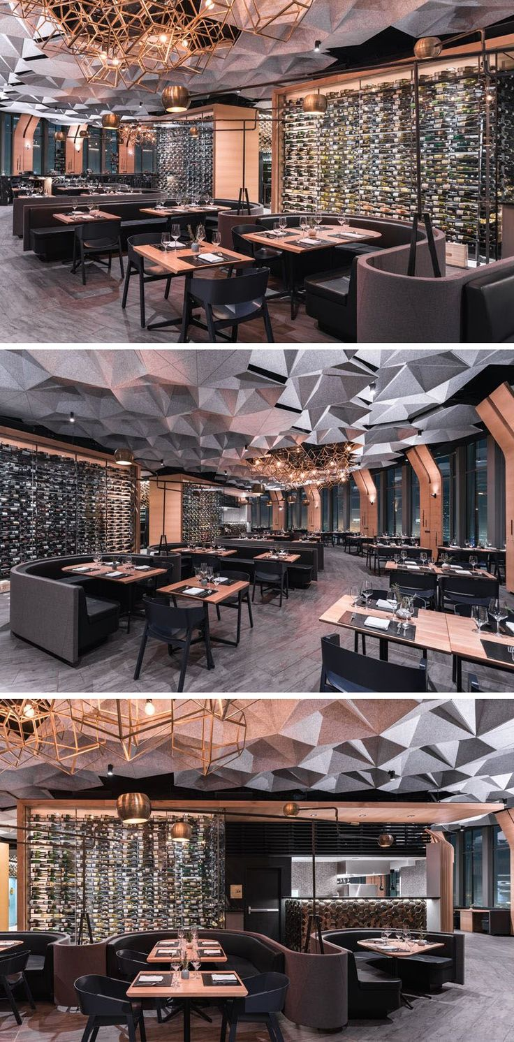 This modern restaurant has large glass walls located behind the dining booths that show off the wine selection available for guests. #WineStorage #WineWall #Restaurant