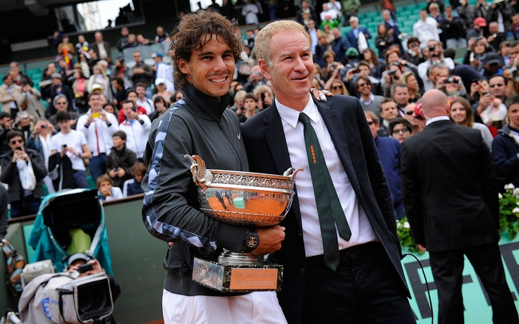 11 Jun - Nadal and McEnroe, two great champions. Rafael Nadal poses with John McEnroe.