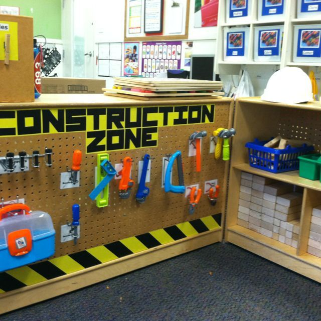 Awesome pretend play corner! Hang your tool kit just like in dad's garage. All you need is a standard peg board and hangers and they'll fit toy tools just as well as real ones.