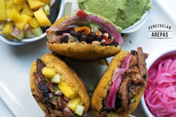 Even while sharing a similar history, the arepas from Venezuela are far different from their Colombian counterparts. Click to see why