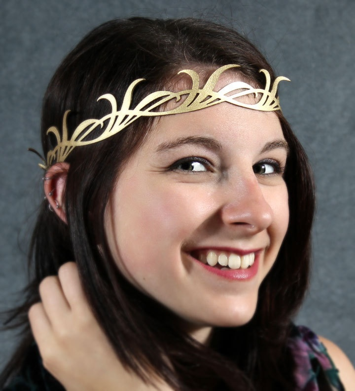 I'm in love with this... I don't think I could pull it off, but I would love to try...     Long leaves crown in gold. $29.00, via Etsy.