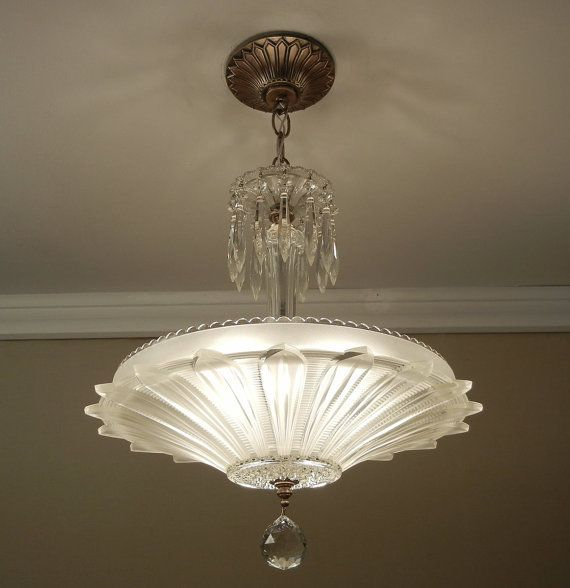 Glamorous best describes highly popular Sunflower or Petal chandelier from the late 1930s through the 1940s. This piece has a beautiful clear